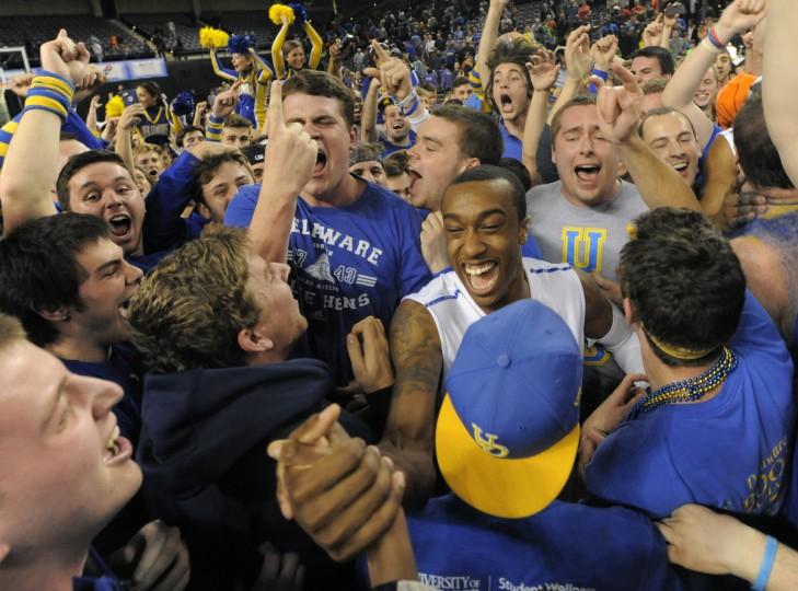 Delaware #4 Jarvis Threatt celebrates with fans after winning the CAA Men's 2014 CAA basketball tournament. (Lloyd Fox/Baltimore Sun)