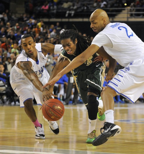 Delaware #4 Jarvis Threatt (L) and teammate #2 Barnett Harris (R) double team William & Mary #3 Marcus Thornton in the second half. (Lloyd Fox/Baltimore Sun)