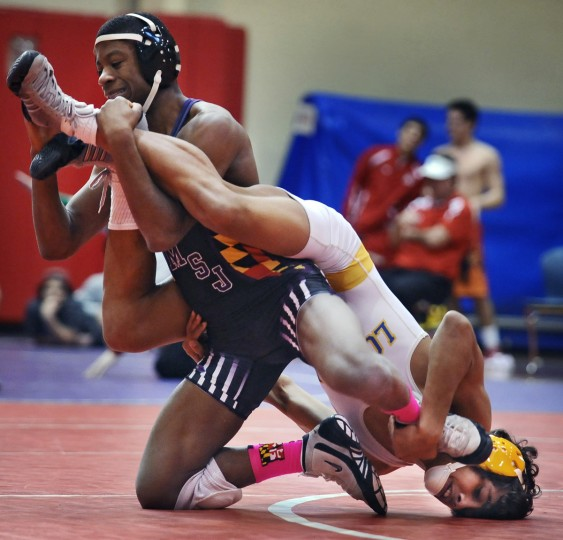 Mount St. Joseph's Malik Woody, left, wrestles Loyola's Dominick Reyes for the 120-pound championship at the Spalding Duals. (Kenneth K. Lam/Baltimore Sun)