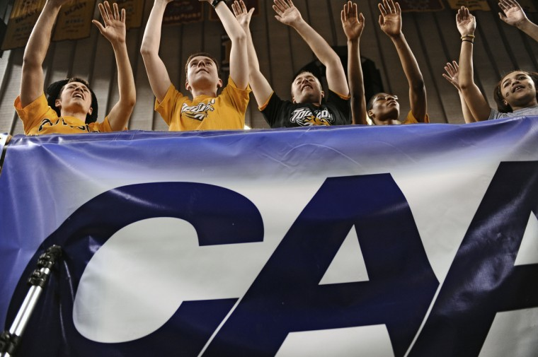 Towson University students cheer for their team late in the second half. Towson University defeated James Madison by score of 80 to 71. (Kenneth K. Lam/Baltimore Sun)