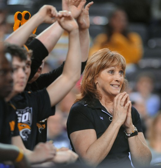 Towson University cheerleading coach Edy Pratt reacts after a successful Towson free throw attempt in the second half. Towson University defeated James Madison. (Kenneth K. Lam/Baltimore Sun)
