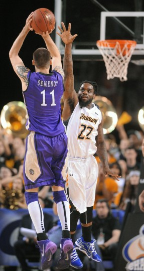 Towson's Rafriel Guthrie, right, defenses against James Madison's Andrey Semenov, left, in the first half. (Kenneth K. Lam/Baltimore Sun)