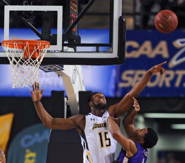 Towson's Timajh Parker-Rivera, left, blocks a shot by James Madison's Charles Cooke, right, in the second half. Towson University defeated James Madison by score of 80 to 71 in CAA quarterfinals at the Baltimore Arena. (Kenneth K. Lam/Baltimore Sun)