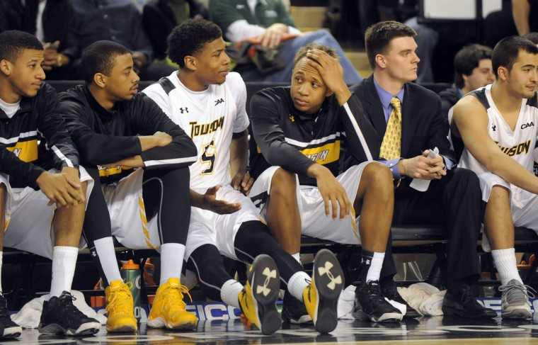 There's mixed reactions on the bench as Towson Tigers players watch their fellow team mates in the last seconds of the game they were loosing to William & Mary. (Algerina Perna/Baltimore Sun)