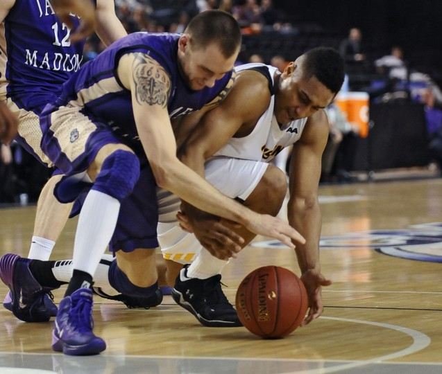 Towson's Jerrelle Benimon, right, battles James Madison's Andrey Semenov for a loose ball in the second half. Towson University defeated James Madison by score of 80 to 71. (Kenneth K. Lam/Baltimore Sun)