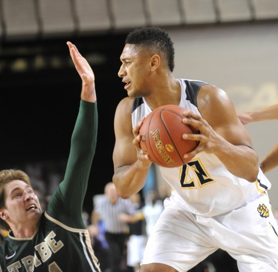 n the first period, Towson Tigers player Jerrelle Benimon #20 tries to pass the ball as William and Mary player Sean Sheldon #31 tries to prevent him in the CAA semifinals. (Algerina Perna/Baltimore Sun)