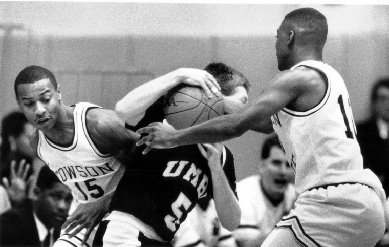 Jan 7, 1989 - UMBC's Larry Simmons tries to maintain control of the ball as Towson's Kurk Lee and Devin Boyd defend. Beltway championship game. (Rich Riggins/Baltimore Sun file photo)