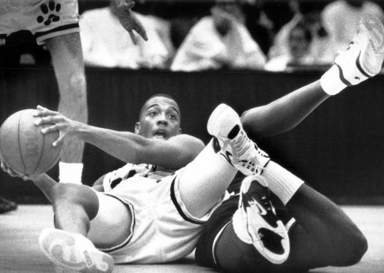Nov. 30, 1990 - Chuck Lightening of TSU looks for someone to pass to as UMBC's Dana Harris tries for the ball during the Beltway tournament. (Rich Riggins/Baltimore Sun file)