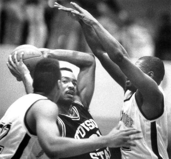 Dec. 6, 1991 - Towson's Terrance Jacobs looks for an open man as UMBC puts on the pressure in the Beltway tournament. (Rich Riggins, Baltimore Sun file)