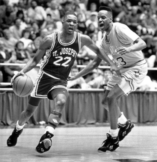 Craig Amos of St. Joseph's dribbles toward the basket at George Washington University. (Rich Riggins/Baltimore Sun file)