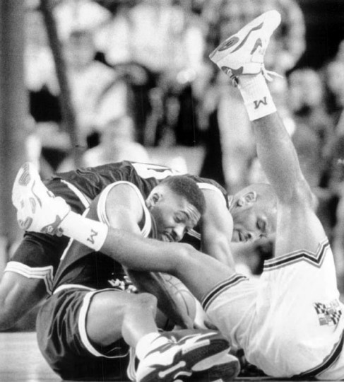 Dec. 23, 1995 - Towson's Andrew Mason and Michel Keys battle for a loose ball against a Maryland player. (Rich Riggins/Baltimore Sun)