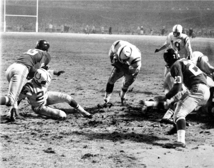 In this Dec. 28, 1958 file photo, Baltimore Colts fullback Alan Ameche advances through a big opening provided by teammates to score the winning touchdown in overtime period against the New York Giants during the NFL Championship football game at Yankee Stadium in New York. Colts' Lenny Moore gets a good block on Giants' Emlen Tunnell (45) at left. Colts quarterback Johnny Unitas (19) is at right along with Giants' Jim Patton (20). The Cotls won 23-17 in overtime for the title. (file photo/Baltimore Sun)