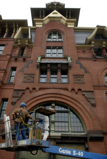 Workers prepare to install new cornices above the main entrance of the old American Brewery, undergoing renovation by Struever Bros. (Amy Davis/Baltimore Sun)