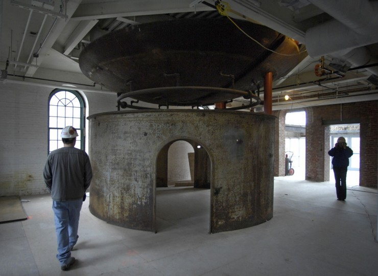 One of two processing tanks at The old American Brewery was opened up to make a useable space, and its 12,000 lb. cover was hoisted above. (Amy Davis/Baltimore Sun)