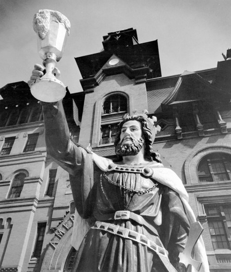 Gambrinus, the patron saint of brewers, hoists a mug of froth in salute outside of the American Brewery. (1973 Baltimore Sun photo)