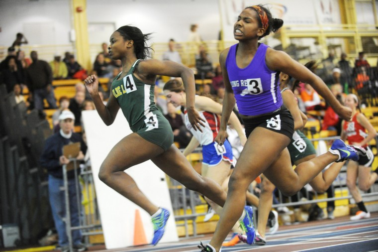 Wilde Lake's Jamila Brown, left, beats Long Reach's Jadah Cadogan to the finish line in the girls 55-meter dash final during the Howard County indoor track championships at Prince George's Sports & Learning Complex. (Brian Krista/BSMG)