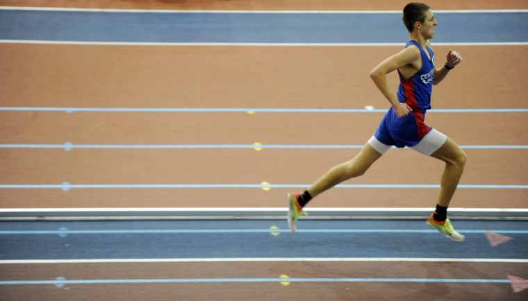 Centennial's Alec Font runs the final stretch of track on his way to victory in the boys 3,200-meter run during the Howard County indoor track championships at Prince George's Sports & Learning Complex. (Brian Krista/BSMG)