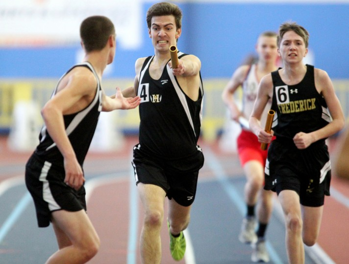 Mt. Hebron's Ben Weinstein, center, passes the baton to Ryan Huyett, left, for the final leg of the boys 3A 4x800 meter relay race during the indoor track and field championships at Prince George's Sports and Learning Complex in Landover. (Jen Rynda/BSMG)