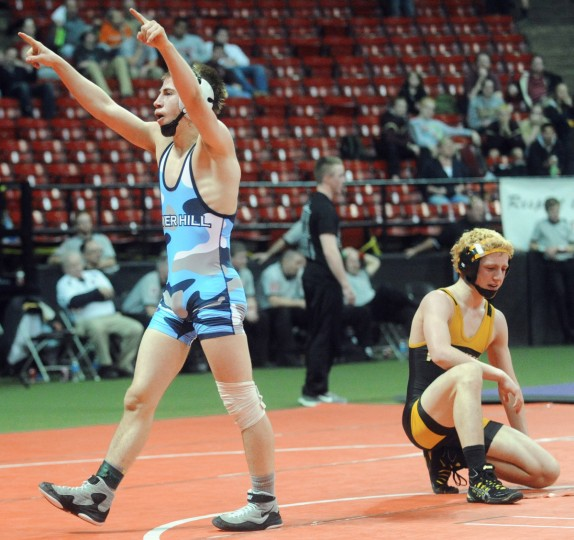 River Hill's Michael Beck, left, celebrates after defeating Mt. Hebron's Jeff Hayden in the finals of the 4A/3A 120-pound weight class during the state wrestling tournament at Maryland. (Brian Krista/BSMG)