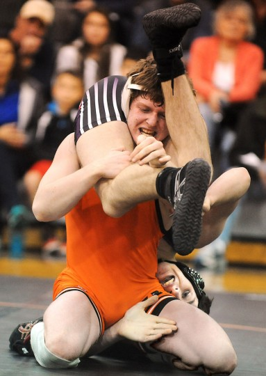 McDonogh's Sam Martino, front, controls Mount St. Joseph's Cornelius Schuster over his shoulders in the 138-pound match. (Brian Krista/BSMG)