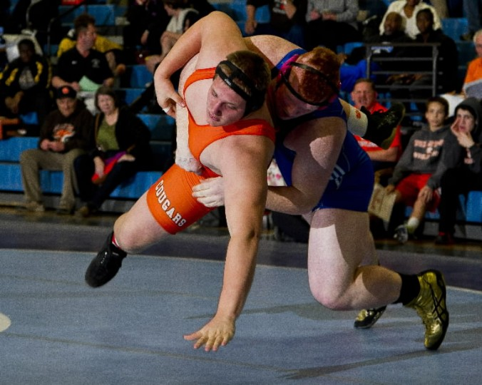 North Caroline's Brion Blades drives Fallston's Alex Helm to the mat before pinning him to win the 285-pound weight class during the MPSSAA 1A/2A East region wrestling championship at North Caroline High School in Ridgely. (Photo by Scott Serio/BSMG)