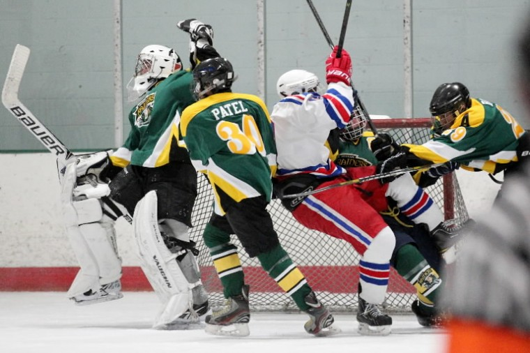 Atholton and Wootton bunch up in front of the Atholton goal during the ice hockey state semifinal at The Gardens Ice House in Laurel on Monday, Feb. 24. (Photo by Jen Rynda/BSMG)