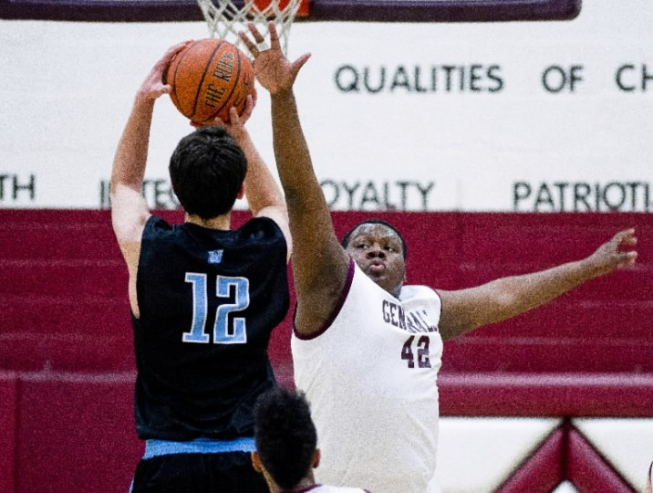 Towson's Joe Jackson tries to block a shot by Westminster's Sklyer Shaffer during the Maryland State 3A boys basketball matchup. (Photo by Scott Serio/BSMG)