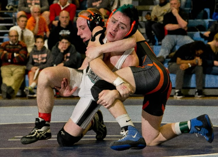 Patterson Mill's Jake Nikkila tries to escape from Rising Sun's Joe Juergens in the 126-pound weight class match during the MPSSAA 1A/2A East region wrestling championship at North Caroline High School in Ridgely. (Photo by Scott Serio/BSMG)