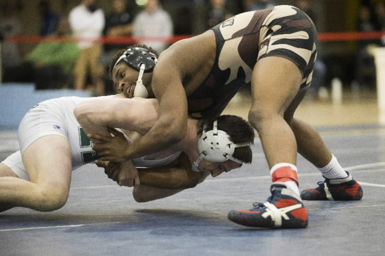 Meade's Travis Chidebe, right, puts pressure on Atholton's Zachary Smith during a match in the East regional wrestling tournament. (Photo by Matt Hazlett/BSMG)