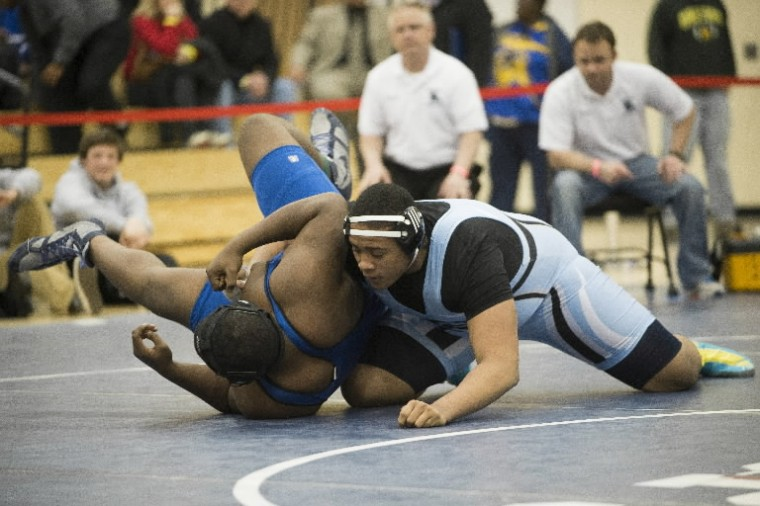 C. Milton Wright's Alan Dorsey, right, takes down Annapolis' Drecon Hudson during a match at the 4A/3A East regional wrestling tournament. (Photo by Matt Hazlett/BSMG)