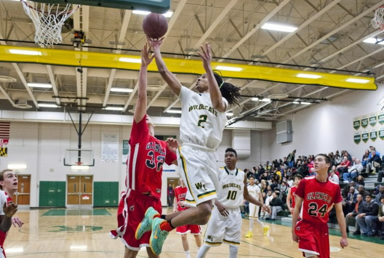 Wilde Lake's Khari Jackson scores with a leaping shot against Glenelg on Friday, Feb. 28 at Wilde Lake High School. (Photo by Noah Scialom/BSMG)