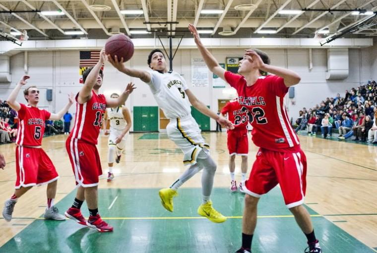 Wilde Lake's Devon Groves shoots against Glenelg on Friday, Feb. 28 at Wilde Lake High School. (Photo by Noah Scialom/BSMG)