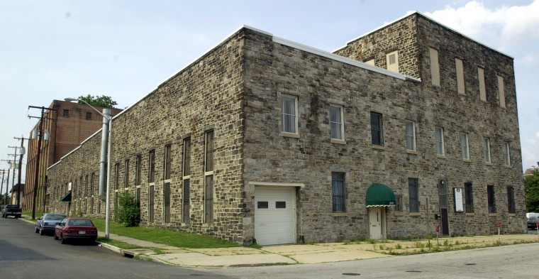 This is the old ice house in the neighborhood of Remington, on Hamden Ave. near 23rd St. Ward Eisinger, a community leader and lab technician, was pushing to get the city to recognize his neighborhood, which includes the ice house, as a historic district. (Algerina Perna/Baltimore Sun/June 29, 2002)