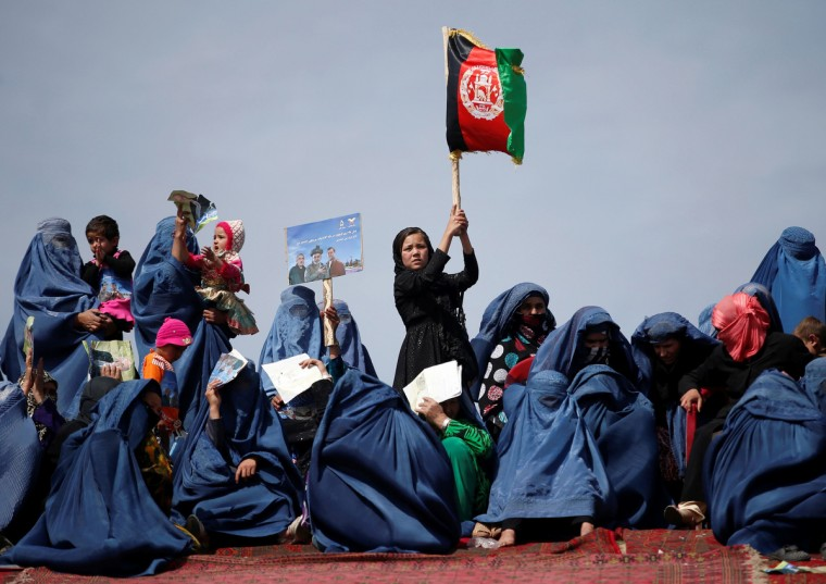 Supporters of Afghan presidential candidate Ashraf Ghani Ahmadzai attend an election campaign in Kunduz province, northern Afghanistan. The Afghan presidential elections will be held on April 5. (Ahmad Masood/Reuters)