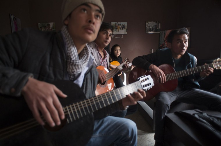 Afghan music students participate in a music training session at a cultural and educational centre in Kabul March 7, 2014. Despite decades of conflict in Afghanistan, and several recent militant attacks, the country's capital Kabul is home to a vibrant youth scene of musicians, artists, athletes and activists. Shopping malls and cafes stand in the city, which is nonetheless beset by infrastructure problems and instability. Afghanistan is preparing for an election on April 5 that should mark the first democratic transfer of power in the country's history, but it has been hit by a tide of violence as the Islamist Taliban movement has ordered its fighters to disrupt the vote and threatened to kill anyone who participates. Picture taken March 7, 2014. (Morteza Nikoubazl/Reuters)