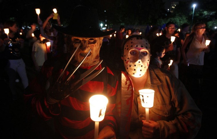 "People dressed as Freddy Krueger and Jason from ""Friday the 13th"" pose for a picture outside the Galileo Galilei planetarium during Earth Hour in Buenos Aires on March 29, 2014. (REUTERS/Marcos Brindicci)"