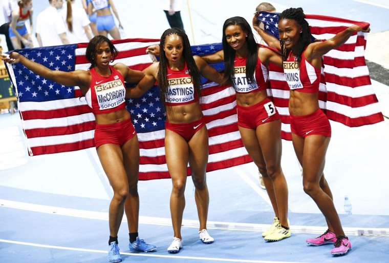 U.S. athletes Francena McCorory, Natasha Hastings, Cassandra Tate and Joanna Atkins (from left) pose as they celebrate after a first-place finish in the women's 4x400 meter relay final at the world indoor athletics championships in Sopot, Poland, March 9, 2014. (Kacper Pempel/Reuters)