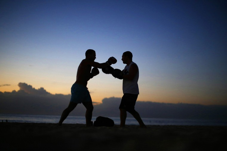 A boxer and his trainer practice before sunrise on Sydney's Bondi Beach, March 11, 2014. Australia's most famous beach is the venue for several outdoor bootcamp-style classes throughout the year, many beginning in the early hours of the morning. (Jason Reed/Reuters)