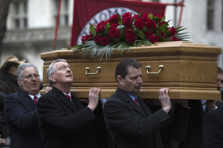 Hilary Benn (2nd L) looks up as he carries his father, Tony Benn's coffin, during the funeral of the veteran British Labour at St Margaret's Church, Westminster Abbey in London March 27, 2014. Tony Benn, who was born into the aristocracy but became a champion of the left died on March 14 aged 88. (Neil Hall/Reuters)