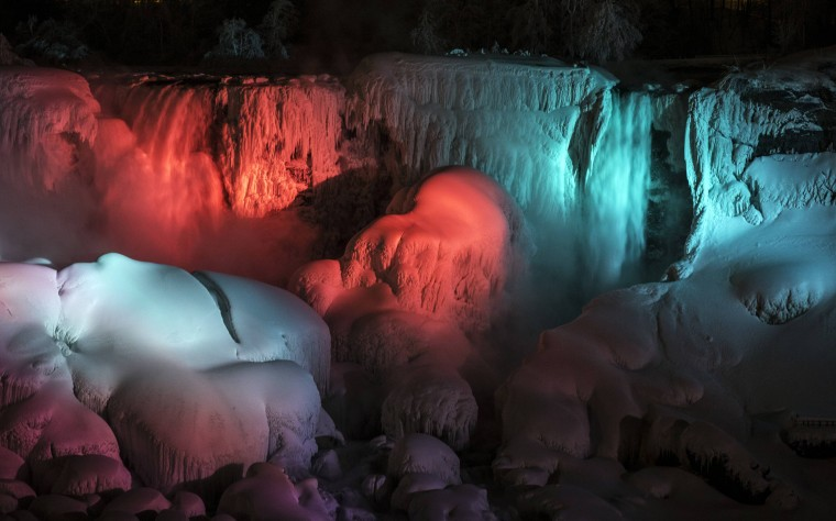 A partially frozen American Falls is seen lit by lights during sub freezing temperatures in Niagara Falls, Ontario March 3, 2014.A partially frozen Niagara Falls is seen on the American side lit by lights during sub freezing temperatures in Niagara Falls, Ontario March 3, 2014. (REUTERS/Mark Blinch)