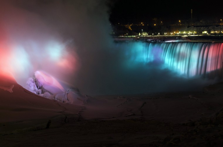 A partially frozen base of Horseshoe Falls is seen on lit by lights during sub freezing temperatures in Niagara Falls, Ontario March 3, 2014. A partially frozen American Falls is seen lit by lights during sub freezing temperatures in Niagara Falls, Ontario March 3, 2014.A partially frozen Niagara Falls is seen on the American side lit by lights during sub freezing temperatures in Niagara Falls, Ontario March 3, 2014. (REUTERS/Mark Blinch)