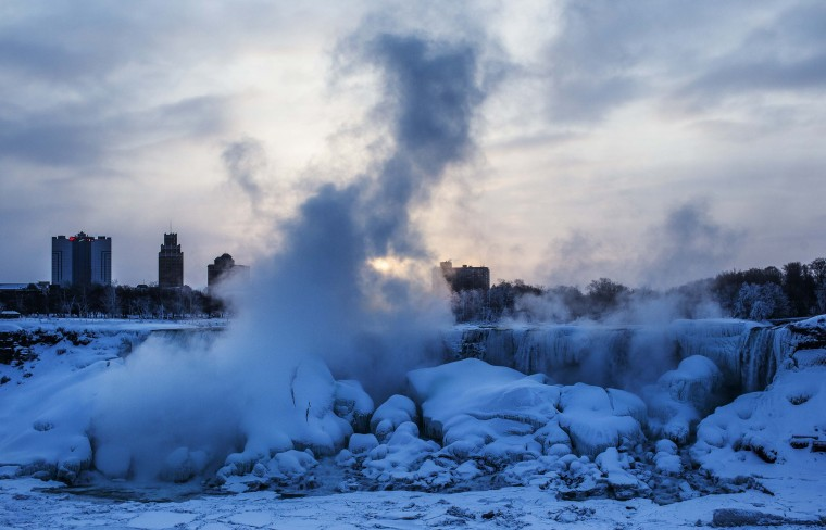 A partially frozen Niagara Falls is seen on the American side during sub freezing temperatures in Niagara Falls, Ontario, March 3, 2014. (REUTERS/Mark Blinch)