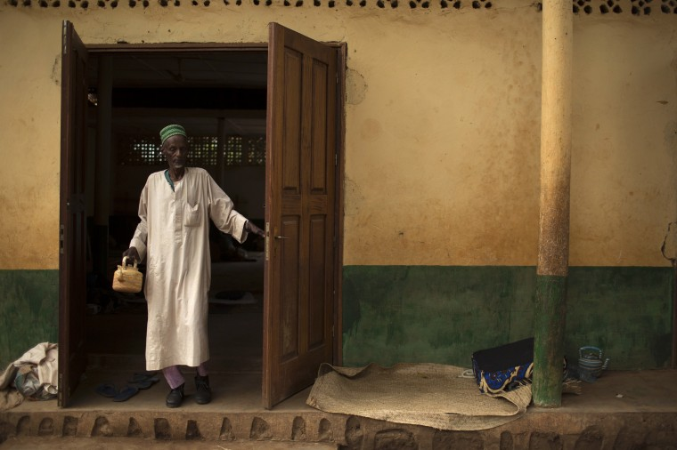 A man walks out of a mosque near Kilometre 12 (PK12) where internally displaced muslims are stranded due to the ongoing sectarian violence in Bangui March 6, 2014. (REUTERS/Siegfried Modola)