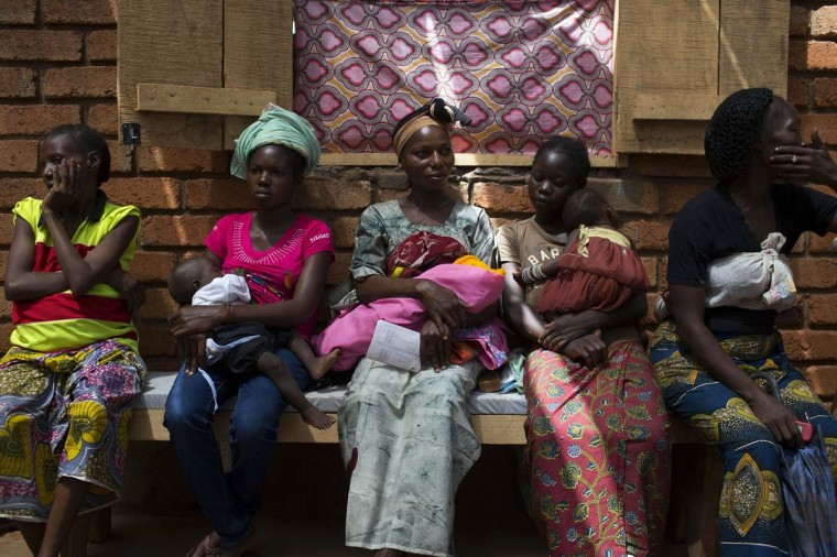Women wait to have their babies examined at a Medecins Sans Frontieres (MSF) hospital near the airport of the capital Bangui March 4, 2014. (Siegfried Modola/Reuters)