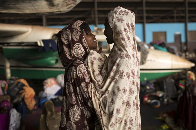 Youths chat in an airplane hangar, which is being used to shelter Muslims fleeing ongoing sectarian violence, at the airport of the capital Bangui March 4, 2014. (Siegfried Modola/Reuters)
