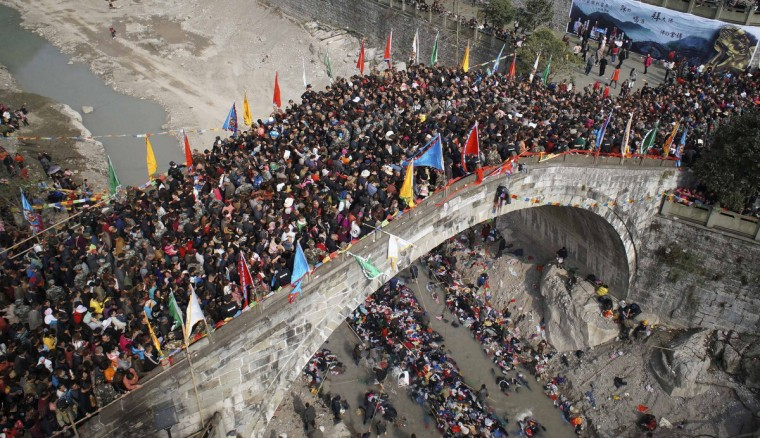 People crowd onto a bridge during the annual Caiqiaohui event in Mianyang, Sichuan province. People believe that by stepping onto the bridge during the three-day spring event can help them escape tribulations and illnesses. (Reuters)
