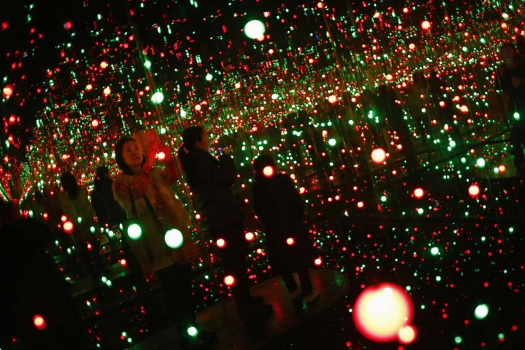 People visit the art exhibition 'A Dream I Dreamed' by Japanese artist Yayoi Kusama at the Museum of Contemporary Art of Shanghai, March 25, 2014. Kusama was born in Nagano, Japan in 1929, today she is acknowledged as one of the most important living artist of Japan. The exhibition will be open until March 30, 2014. (Carlos Barria/Reuters)