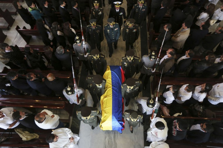 Colombian police commanders carry the casket of Major German Mendez of the Colombian police force during his funeral at a religious center in Bogota March 20, 2014. Mendez and patrol officer Edilmer Ortiz were killed on Tuesday by the Revolutionary Armed Forces of Colombia (FARC) in the province of Tumaco, according to local media. (REUTERS/ John Vizcaino)
