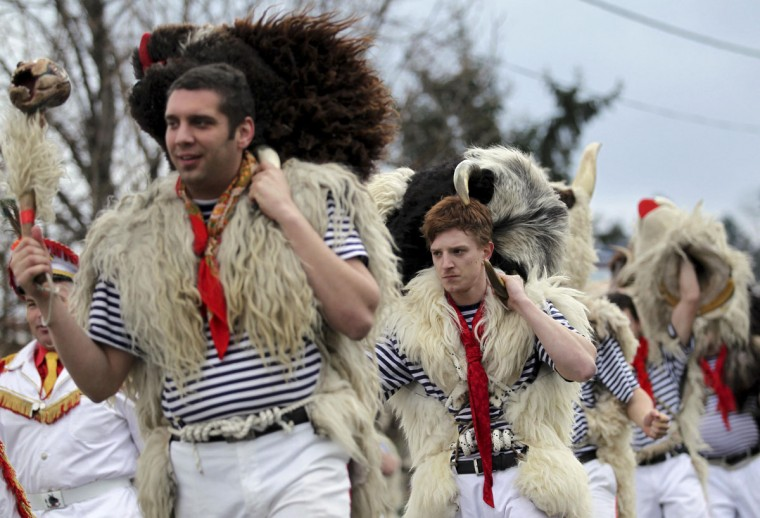 "Bell ringers, or ""Zvoncari"", take part in a parade in a village near Rijeka, Croatia, March 2, 2014. (Antonio Bronic/Reuters)"
