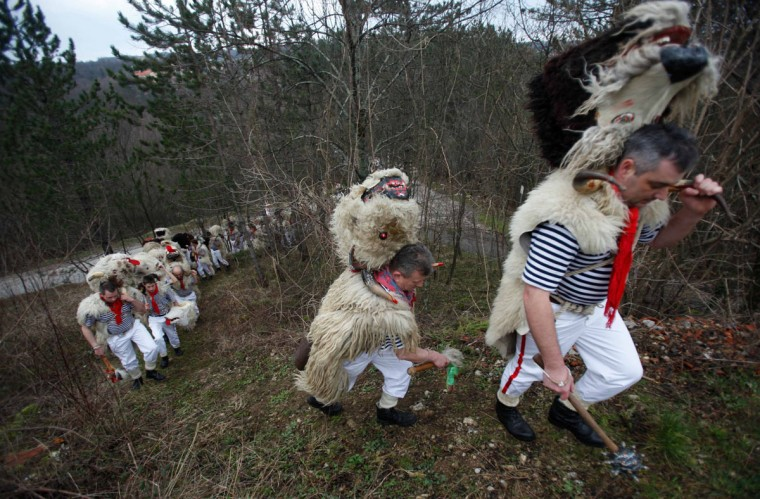"Bell ringers, or ""Zvoncari"", walk in a village near Rijeka, Croatia, March 2, 2014. (Antonio Bronic/Reuters)"